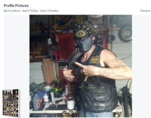 Facebook image of an Upsher County Cossack with a riding mask in his garage, where there happens to be a Nazi war flag hanging behind him. Circa 2014.