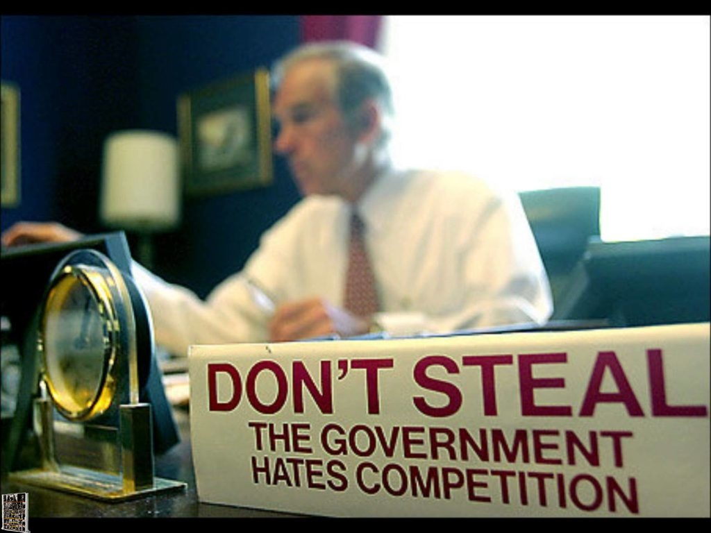 Ron Paul - Former Congressman with Do Not Steal - The Government hates competition sign on his desk.
